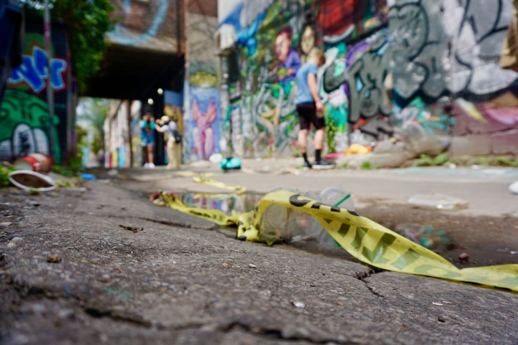 a close up of rubble on the floor in graffiti alley