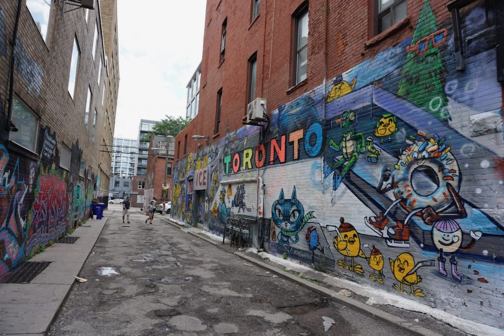 a view down graffiti alley with a Toronto themed mural